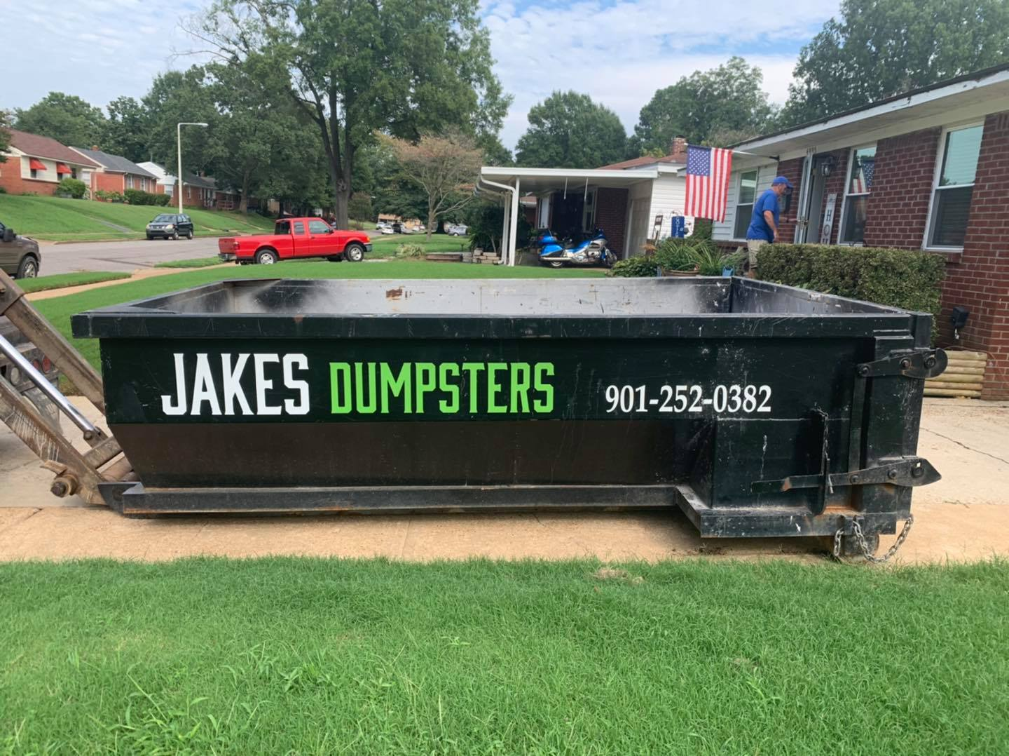 roll off dumpster in driveway