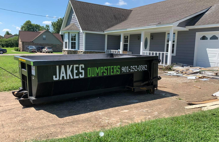 dumpster sitting in driveway